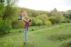 Cute little child playing outdoor with dad Stock Image