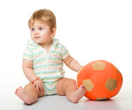 Cute little child is playing with soccer ball Royalty Free Stock Photography