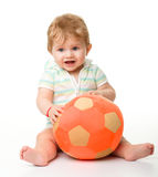 Cute little child is playing with soccer ball Royalty Free Stock Images