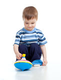 Cute little child playing with toys Stock Photos