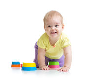 Cute little child is playing with toys royalty free stock image