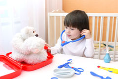 Cute little child plays doctor Royalty Free Stock Images