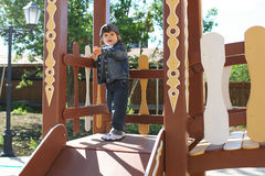 Cute little child plays on wooden playpit Stock Photo