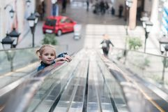 Cute little child in shopping center standing Royalty Free Stock Photo