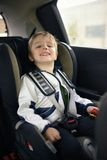 Cute little child sitting in safety car seat Royalty Free Stock Photography