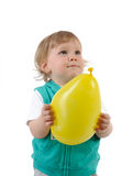 Cute Little Child Smiling And Holding A Baloon Stock Photo