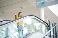 Cute little child standing on moving staircase Royalty Free Stock Images