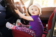 Child steering wheel in the car. Cute little child steering wheel in the car Stock Images