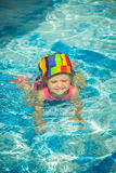 Cute little child swimming in pool Royalty Free Stock Photo