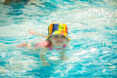 Cute little child swimming in pool Royalty Free Stock Photography
