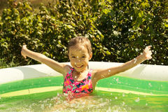 Cute little Child in swimming pool. Summer outdoor. Stock Photo