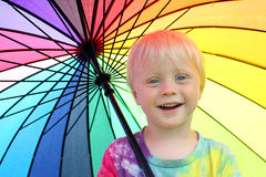 Cute Little Child Under Rainbow Colored Umbrella Royalty Free Stock Image