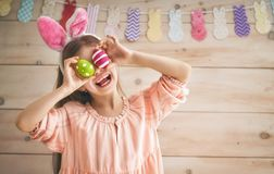Girl holding basket with painted eggs Stock Photography