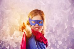 Cute little child is wearing a superhero fancy dress. Royalty Free Stock Photo