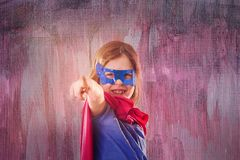 Cute little child is wearing a superhero fancy dress. Royalty Free Stock Photos