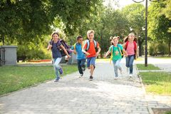 Cute little children with backpacks running outdoor. S. Elementary school royalty free stock photography