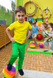 Cute little children at daycare gym Stock Image