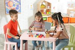 Cute little children drawing at painting lesson. Indoors royalty free stock photo