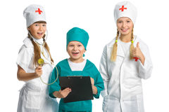 Cute little children dressed like doctor looking Stock Image