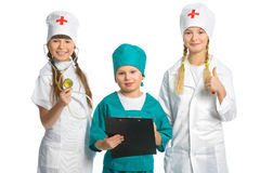 Cute little children dressed like doctor looking Royalty Free Stock Photography