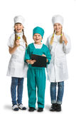 Cute little children dressed like doctor looking Stock Photos