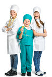 Cute little children dressed like doctor looking Stock Images