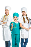 Cute little children dressed like doctor looking Stock Photo