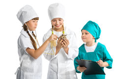 Cute little children dressed like doctor treated Stock Photo