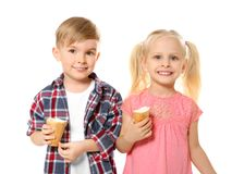 Cute little children eating ice cream on white background Royalty Free Stock Images