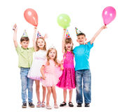 Cute little children with hands uo and baloons. Cute little children laughing with hands up and colorful baloons royalty free stock images