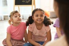 Free Cute Little Children Listening To Teacher. Kindergarten Playtime Activities Royalty Free Stock Image - 156572776