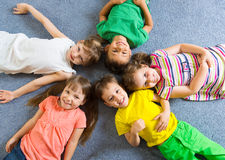 Cute little children lying on floor Royalty Free Stock Photography