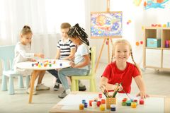 Cute little children painting at lesson. Indoors royalty free stock images