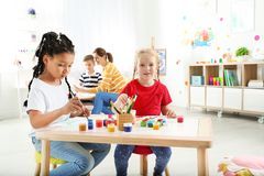 Cute little children painting at lesson. Indoors stock photos