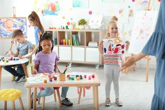 Cute little children at painting lesson. Indoors stock image