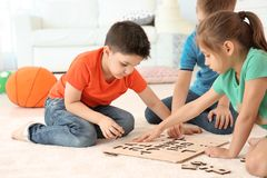 Cute children playing together on floor, indoors Stock Images