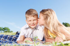 Cute little children sitting on the blanket Royalty Free Stock Photography