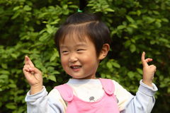 Cute little Chinese girl. In spring times Royalty Free Stock Images