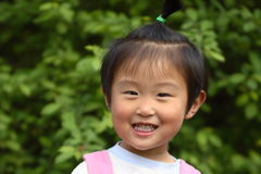 Cute little Chinese girl. In spring times Stock Photography