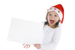 Cute little christmas girl with a blank sign Royalty Free Stock Images