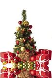 Cute little christmastree with ornaments. And presents Stock Images