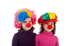 Cute little clowns. Closeup image of two cute little clowns Royalty Free Stock Images