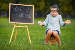 Cute little confused student Royalty Free Stock Photos