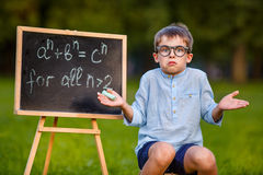 Cute little confused student stock photography