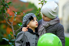 Cute little couple in love. Children outdoors royalty free stock image