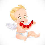 Cute little cupid sitting on the floor and holding a garland Royalty Free Stock Image