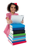 Cute little curly haired girl using tablet pc Stock Photos