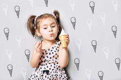 Cute little cute girl play the toy ice cream. Portrait of cute little cute girl play the toy ice cream Royalty Free Stock Images