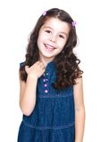 Cute little dark-haired girl in denim dress gently Stock Photos