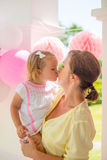 Cute Little Daughter Gives Big Kiss to Mother Royalty Free Stock Photography